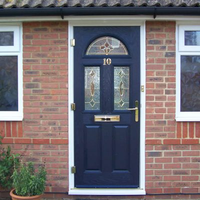 Dark blue composite door with gold hardware