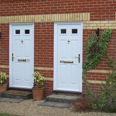 Dual white composite entrance doors