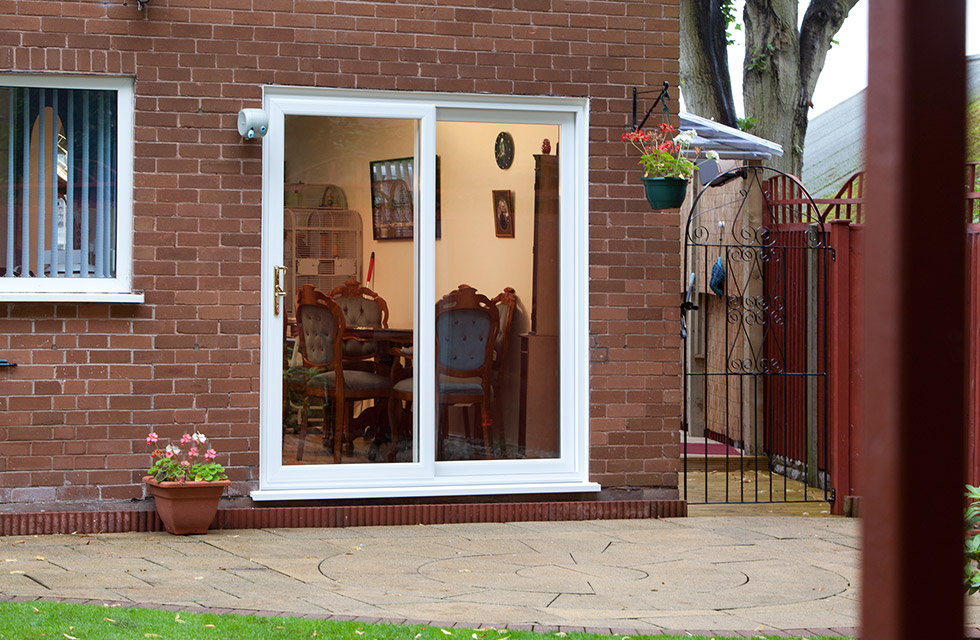 White Patio Doors with Gold Handle